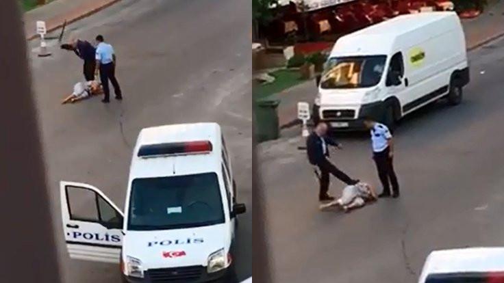 Polis yerde yatan kadını darp etti
