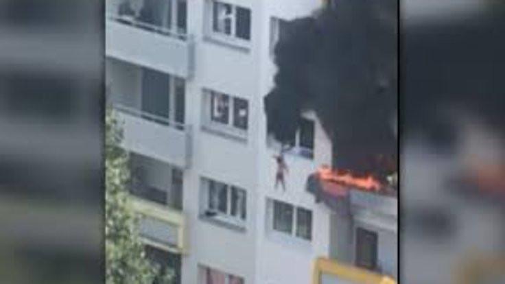 Yangın çıkan evden atladılar, komşular kurtardı