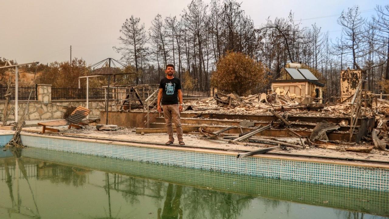 Altı kişilik aile havuza girerek yangıdan kurtuldu