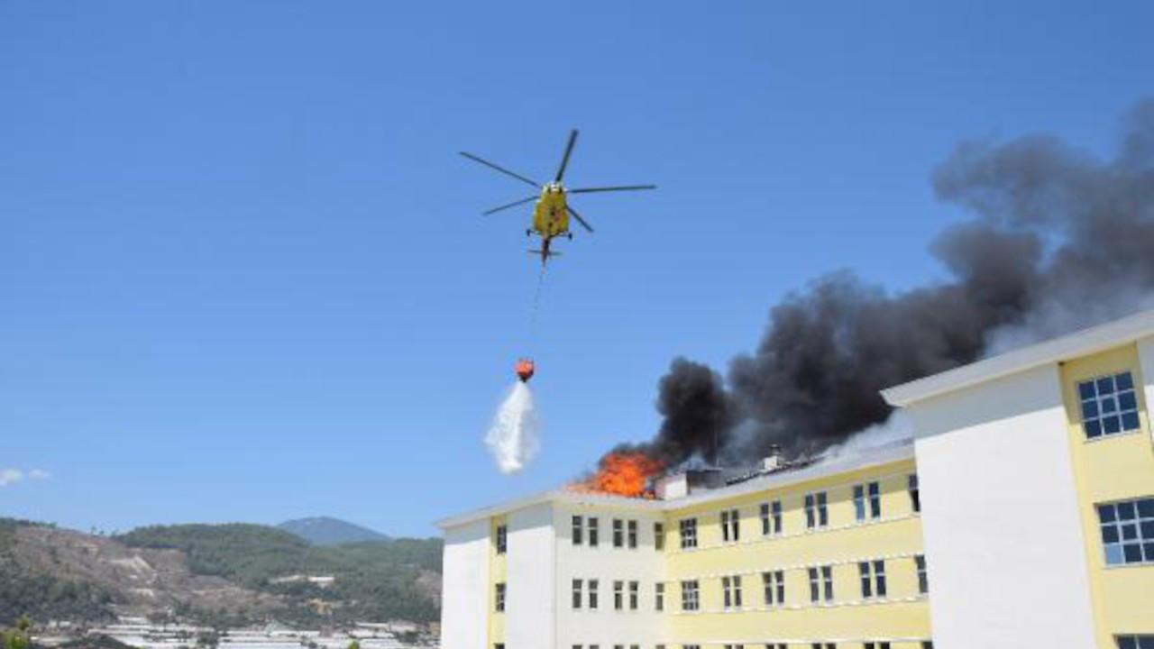 Yurt çatısındaki yangın helikopterle söndürüldü